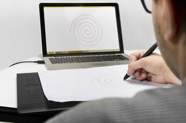 Image shows a person coping a spiral drawing.