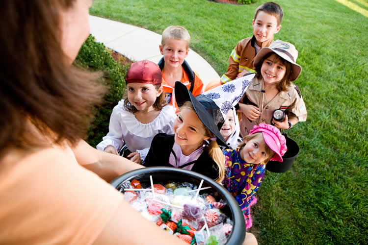 Image shows kids trick or treating.
