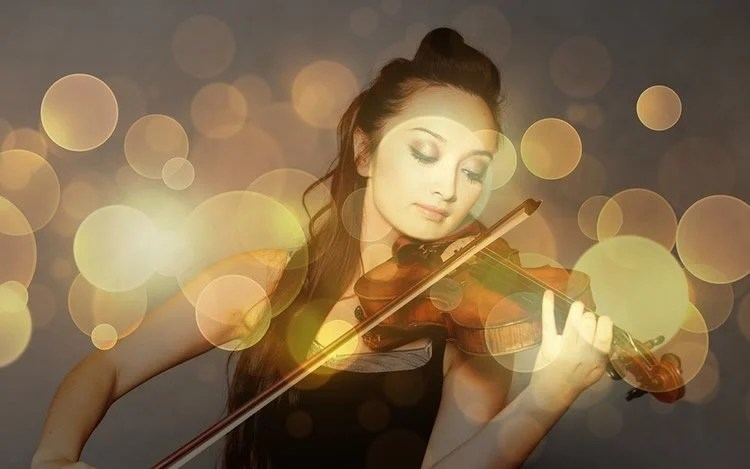 Image shows a woman playing a violin.