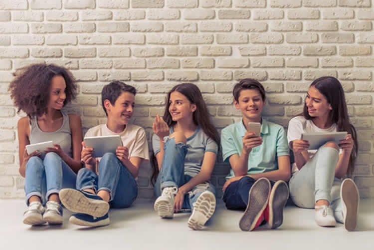 Image shows a group of teens.