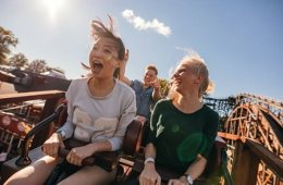 Image shows people on a rollercoaster.