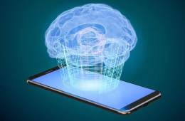 Image shows a virtual brain being projected from a smart phone.
