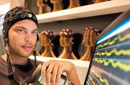 a man in an EEG cap