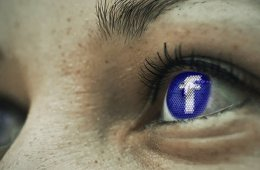 facebook logo in woman's eye