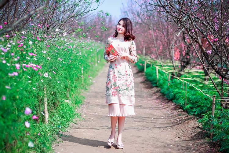 a woman walking in flowers