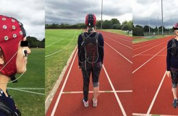Image shows a person in an EEG cap on a running track.