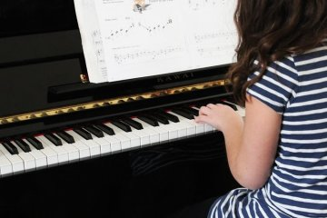 girl playing piano