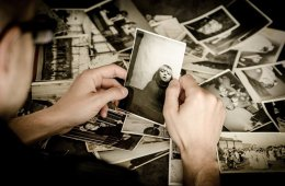 a person looking at photos