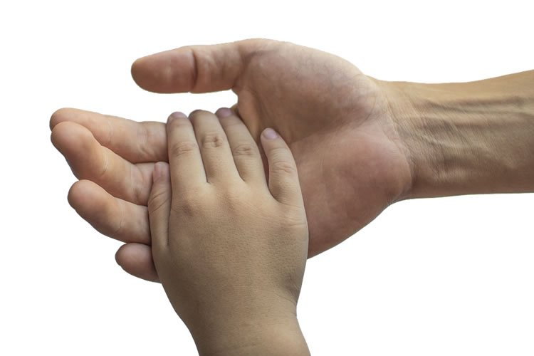 a dad holding a child's hand.