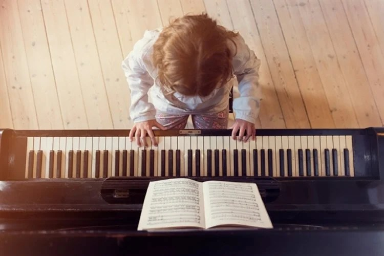 a child playing piano