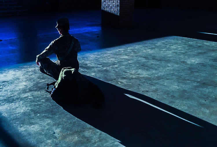 a soldier sitting meditating