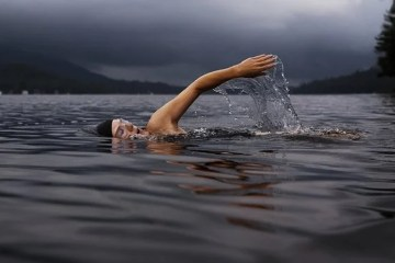 a person swimming in a lake