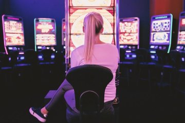 a woman sitting at a slot machine