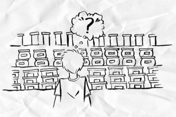 a person looking at supermarket shelves