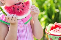 a girl eating fruit