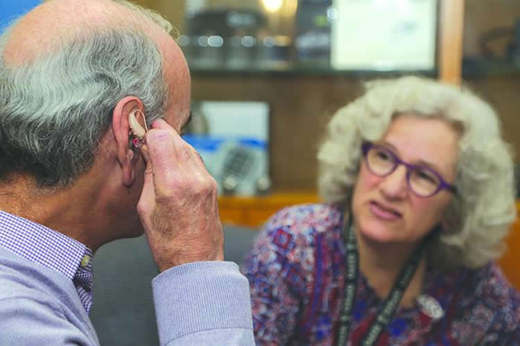 a man with a hearing aid