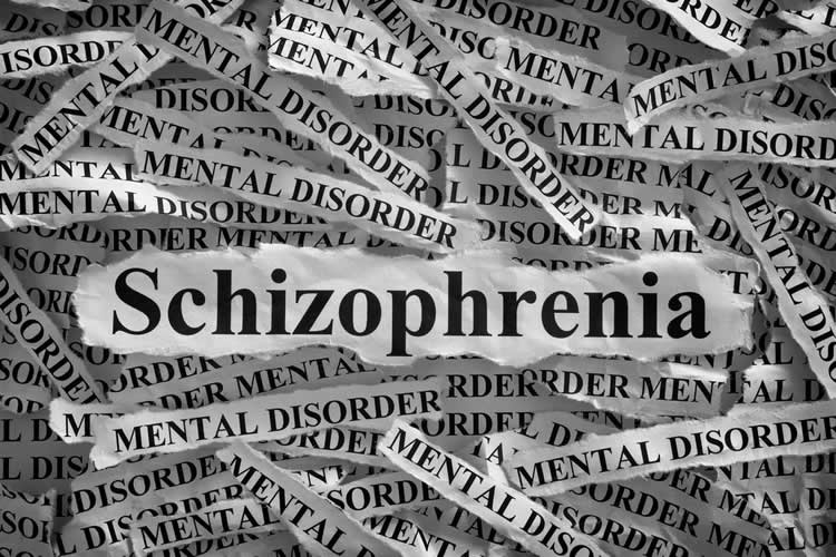 The word Schizophrenia is shown in newspaper print