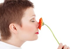 This is a woman smelling a flower