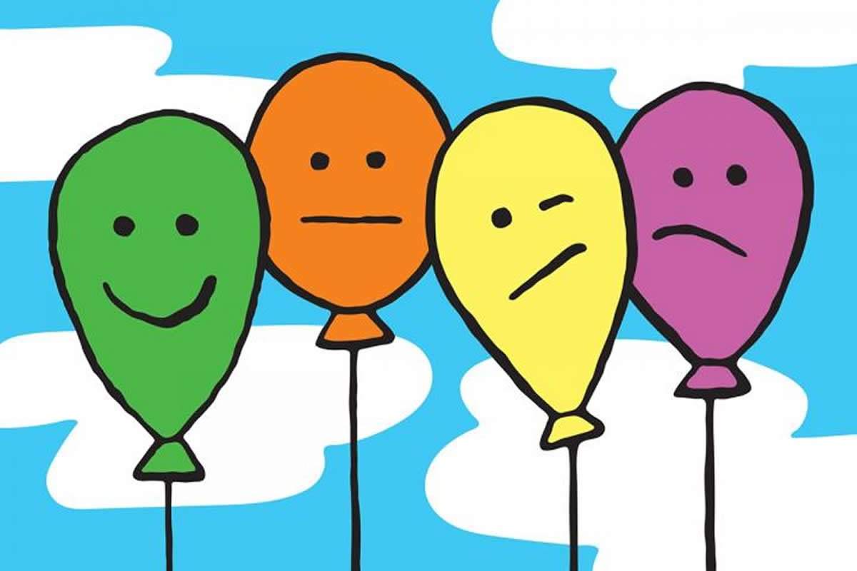 This shows faces drawn on balloons