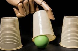 This shows a robotic hand playing the ball under the cup game