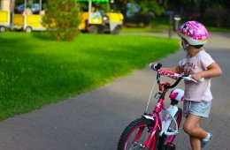 This shows a young girl on a bike