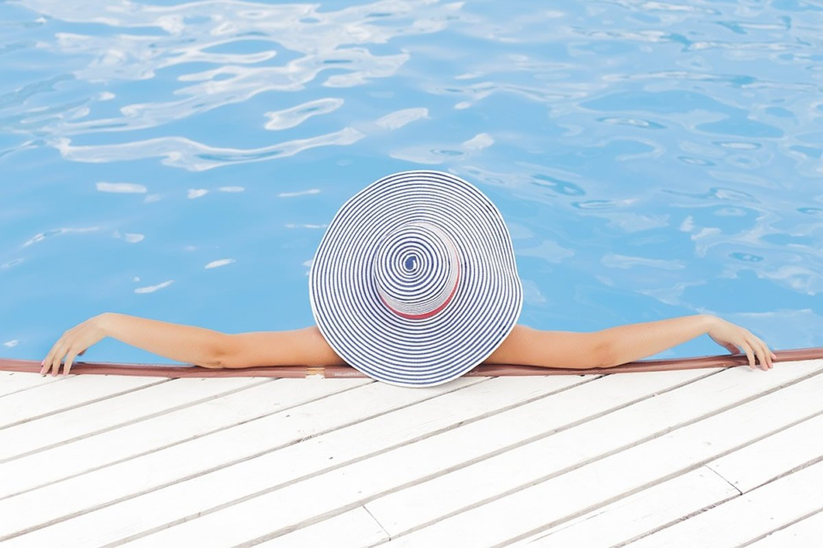This shows a woman relaxing in a pool