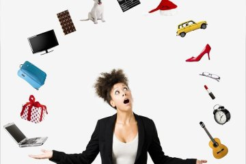 This shows a woman juggling random items such as shoes and a laptop