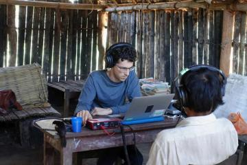 This shows the researcher and a participant wearing headphones