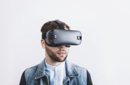 This shows a man in VR glasses