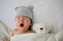 This shows a baby yawning