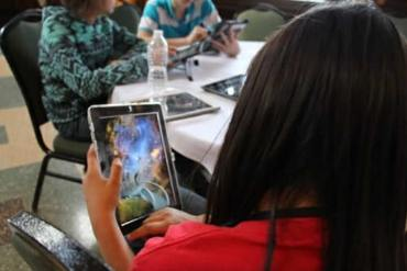 This shows a person playing Tenacity of an ipad