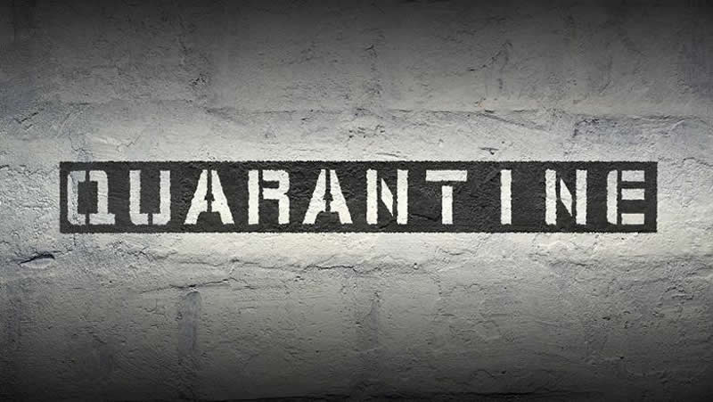 The word Quarantine is sprayed on a wall here