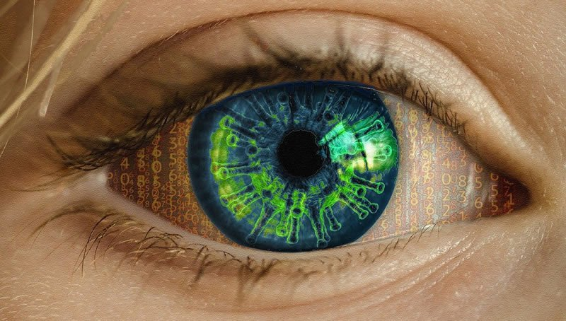 This shows a woman's eye with computer code and covid19