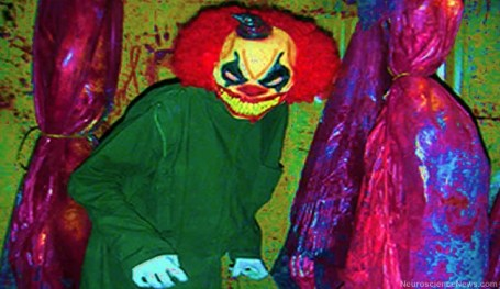 An extremely scary clown is shown.