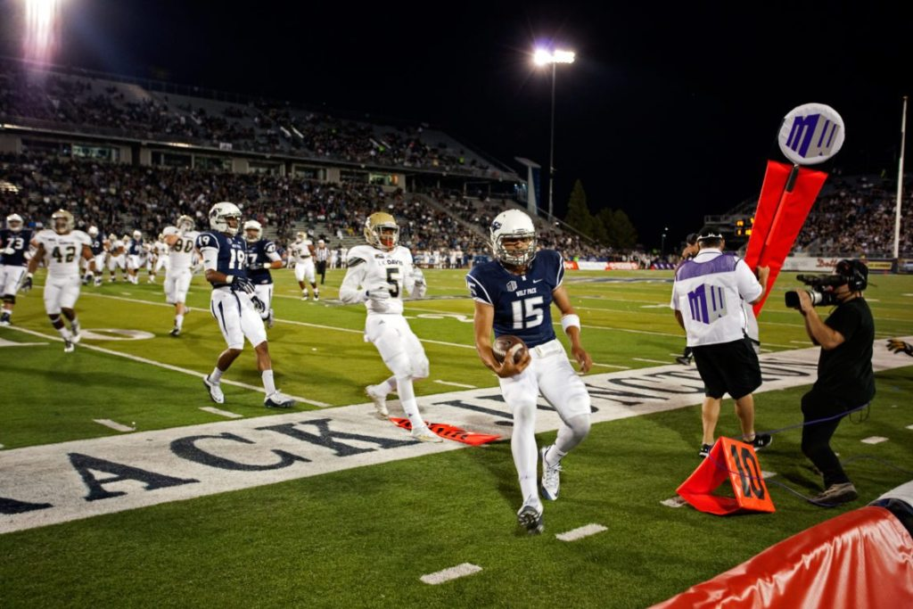 Nevada junior quarterback Tyler Stewart runs the ball out of bounds during the game against UC Davis on Sept. 3 at Mackay Stadium. Stewart used both his feet and his arm in the 31-17 victory over the Aggies.