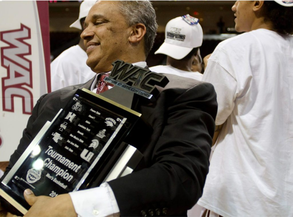 Tony Contini /Nevada Sagebrush New Mexico State basketball head coach Marvin Menzies holds the WAC Tournament Championship trophy Orleans Arena in Las Vegas back in 2012. As the top seed, Nevada lost in the semifinals of the WAC tournament against Louisiana Tech, which paved the way for New Mexico State.