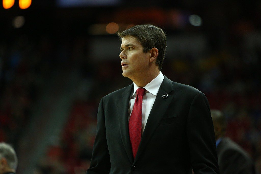 Photo courtesy of Mountain West Conference/NCAA Photos Former UNLV head coach Dave Rice observes his old team at the Thomas and Mack during his final season. Rice was hired as a Nevada assistant coach after being fired by UNLV in January of 2016.