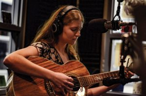 Elspeth Summers plays guitar in the Wolf Pack Radio studio on Sept. 20, 2015. Summers performed an acoustic set as part of Wolf Pack Radio's Live in the 775.