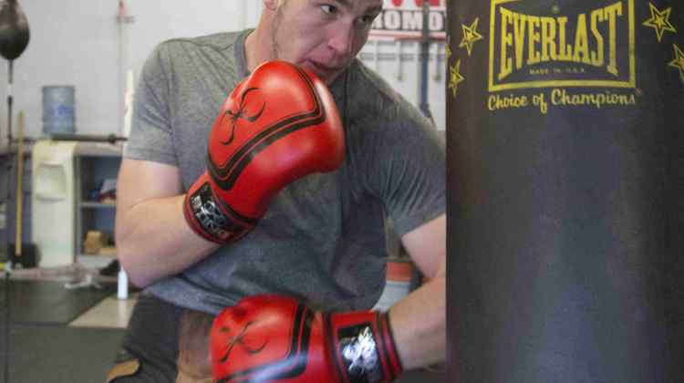 Three-time national champion Garrett Felling strikes a punching bag.