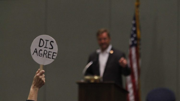 "Jacob Solis/Nevada Sagebrush A town hall attendee holds up a ""disagree"" sign during a joint town hall from Sen. Dean Heller, R-Nevada, and Rep. Mark Amodei, R-Nevada, on Monday, April 17, inside the Reno-Sparks Convention Center. The left-leaning crowd spent nearly two-and-a-half hours grilling the state's only two congressional Republicans."