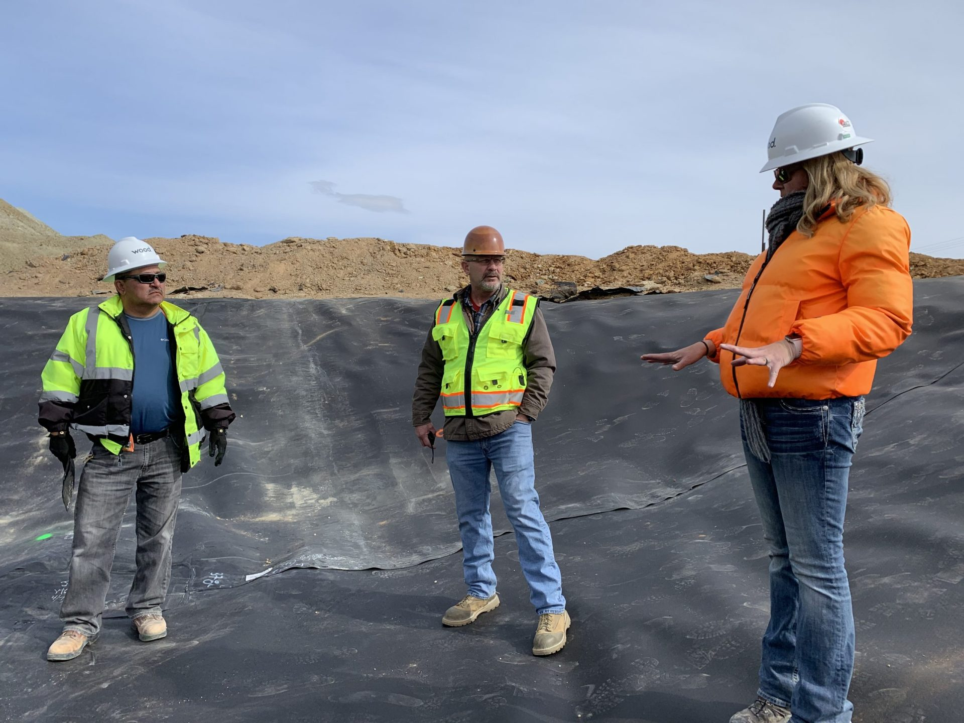 Construction workers survey remediation work a the Anaconda Copper Mine site in Mason Valley.