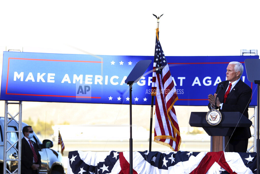 Vice President Mike Pence speaks at a campaign rally at the Reno-Tahoe International Airport in Reno, Nev., Thursday, Oct. 29, 2020. (AP Photo/Lance Iversen)