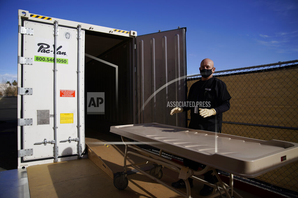 Michael Murphy, a consultant serving as interim Clark County coroner, gives a tour of a refrigerated trailer at the coroner's office Friday, Jan. 8, 2021, in Las Vegas. The trailer is currently unused but is in place in case of a surge in coronavirus deaths. (AP Photo/John Locher)