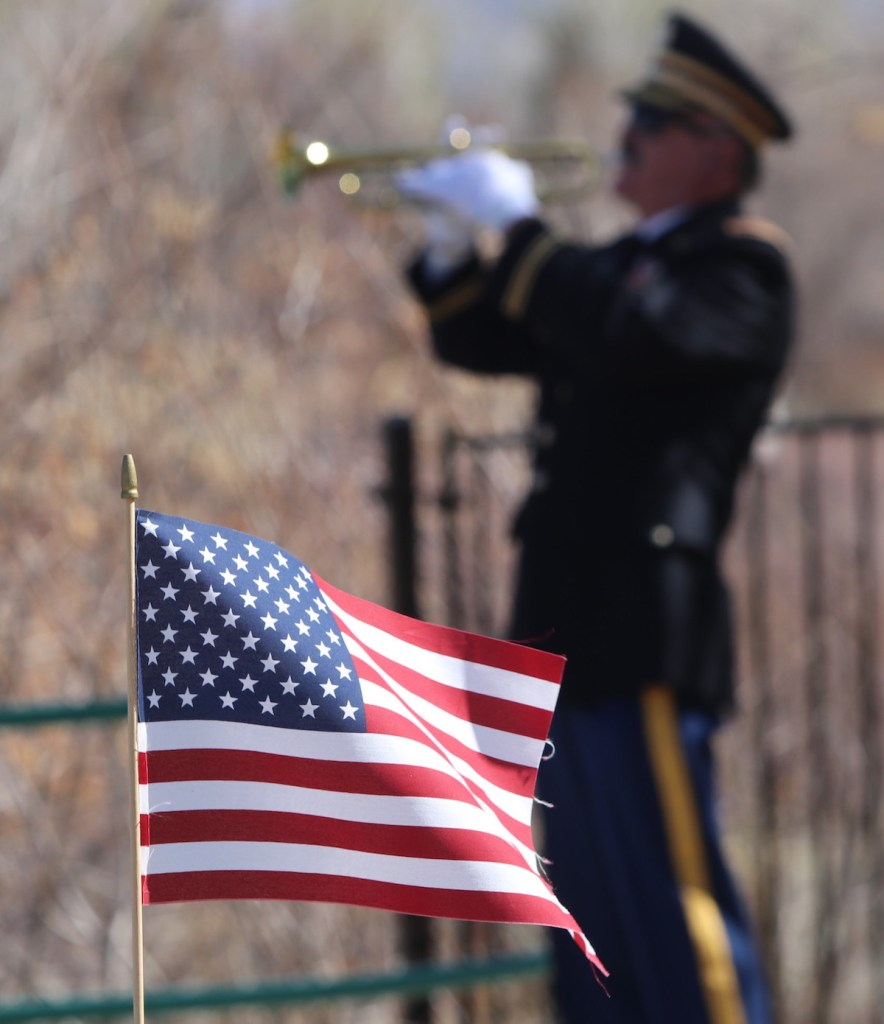 Retired Army Chief Warrant Officer 5 Al Pefley plays echo Taps with another bugler. Steve Ranson / LVN