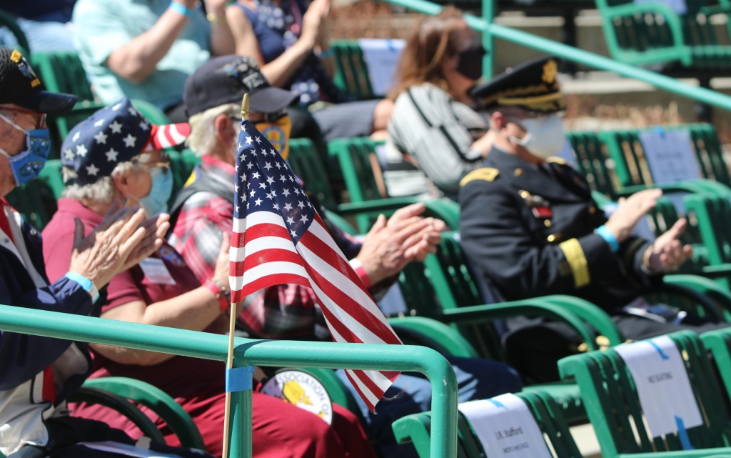 Veterans who attended the National Vietnam War Veterans Day clap after one of the speaker's made a point about sacrifice. Steve Ranson / LVN