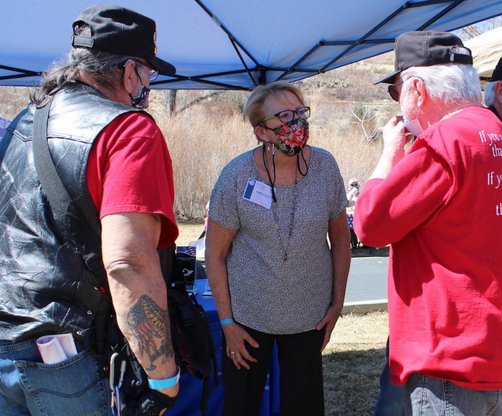 Judge Shelly O'Neill, center speaks with Vietnam veterans Jim Saad, left, and Lou Solsbury. Charlotte LaCombe / LVN