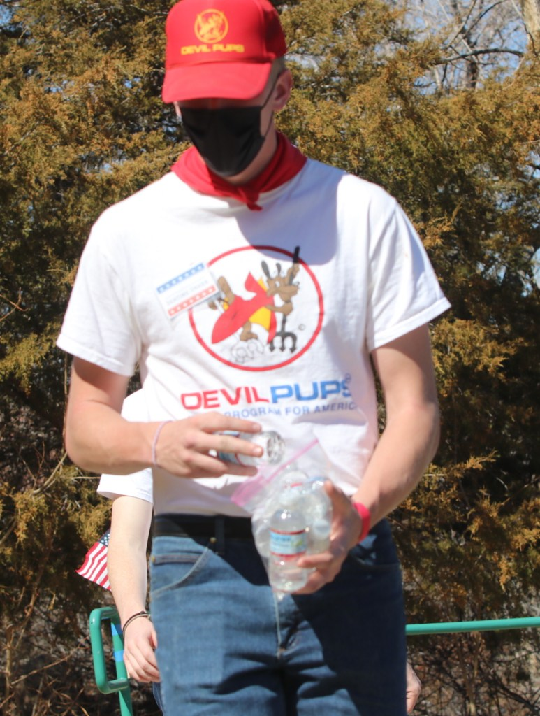 A member of the Devils Pups hands out water during the ceremony. Steve Ranson / LVN