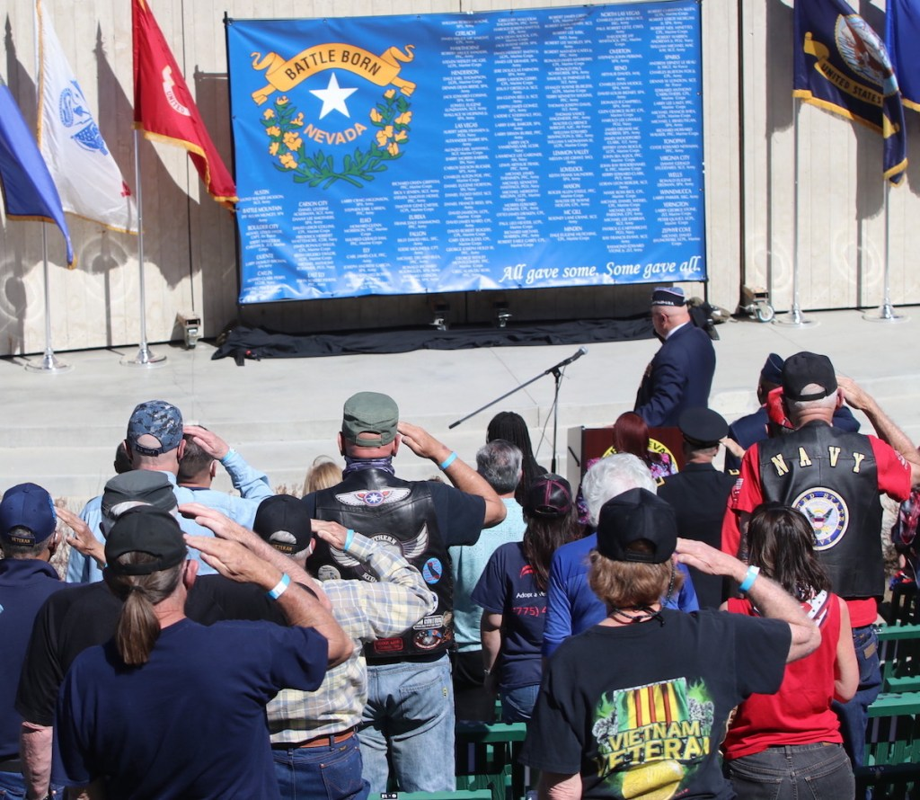 Retired Marine George Malone and other Vietnam War veterans salute a Nevada flag with names of their comrades from the Silver State who died. Steve Ranson / LVN