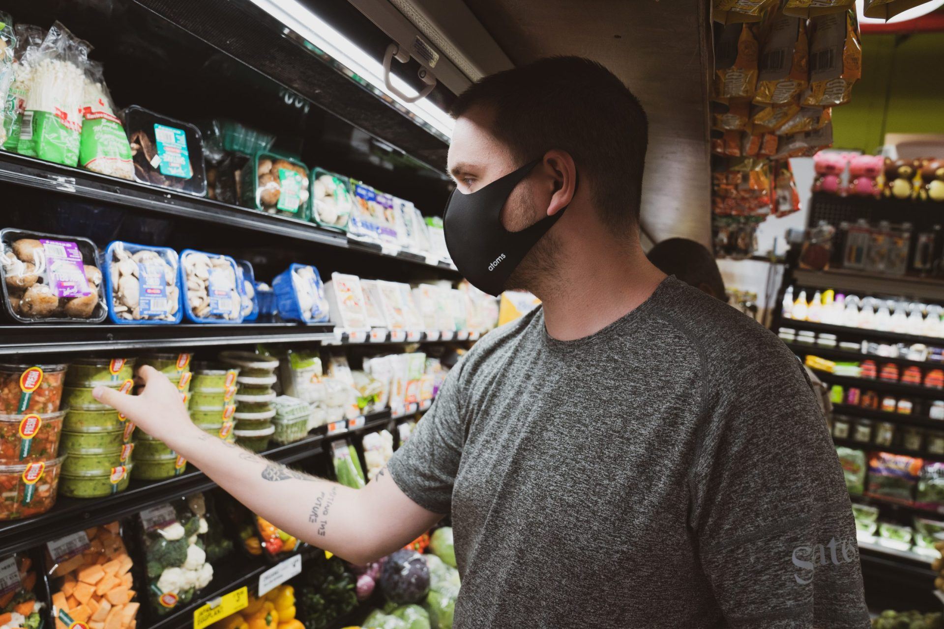 a man wearing a mask at a grocery store