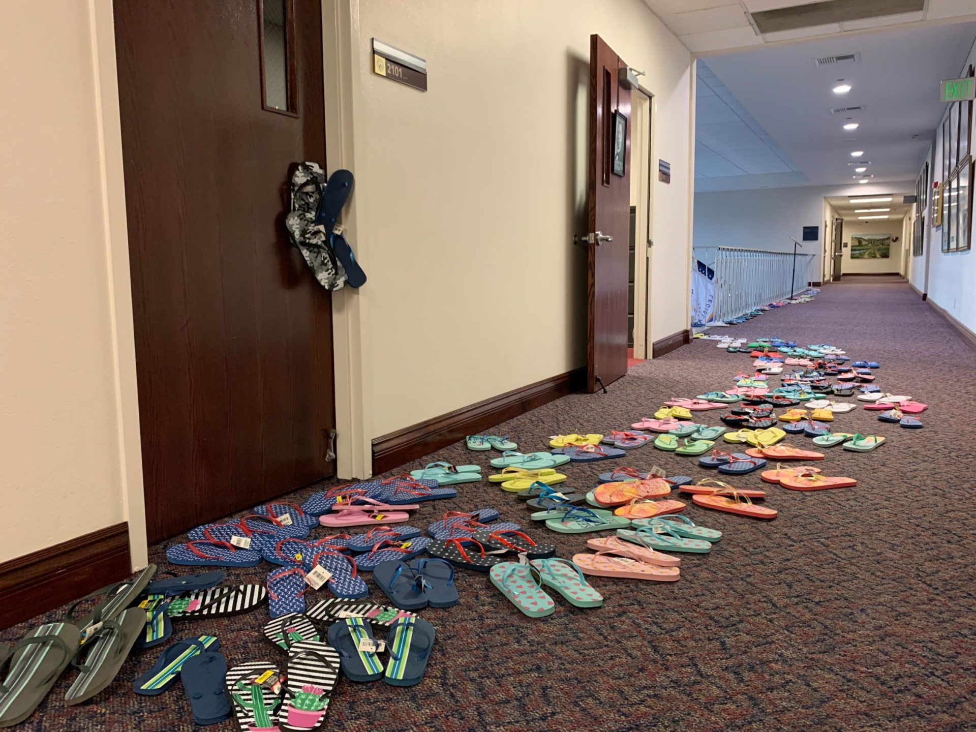 Democrats placed flip flops outside Sen. Keith Pickard's office door during the 31st special session after he said he'd support a mining tax build, then flipped his vote
